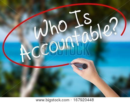Woman Hand Writing Who Is Accountable? With Black Marker On Visual Screen