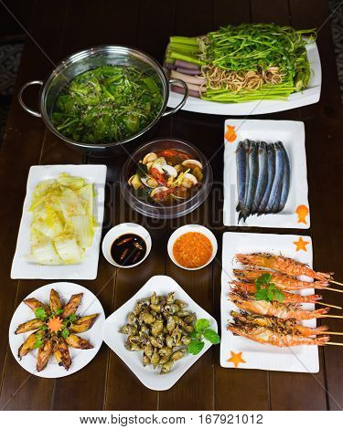 Set Of Vietnamese Seafood With Barbecue Tiger Shrimps, Grilled Squid, Stir Fried Cabbage, Spicy Stea