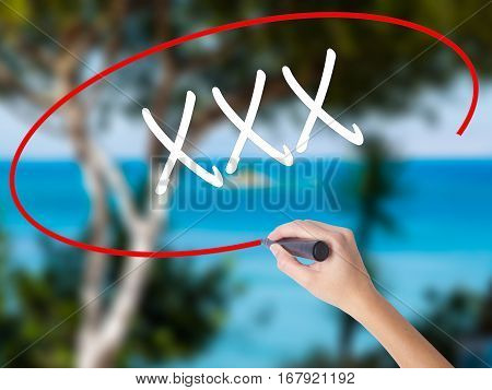 Woman Hand Writing Xxx With Black Marker On Visual Screen