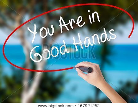 Woman Hand Writing You Are In Good Hands With Black Marker On Visual Screen