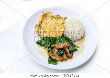Stir Fried Kale With Crispy Pork And Thai Omelette With Rice In White Dish Iisolated On White Backgr