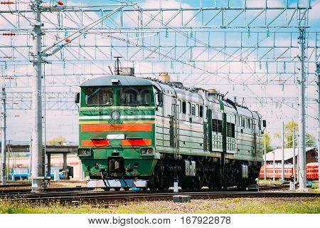 Old Diesel locomotive on Railway In Sunny Summer Day.