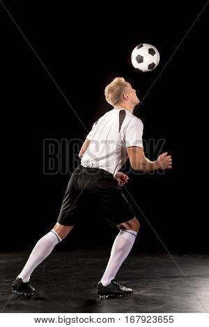 Soccer player bouncing a ball on his head