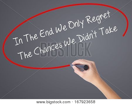 Woman Hand Writing In The End We Only Regret The Chances We Didn't Take With Black Marker On Visual