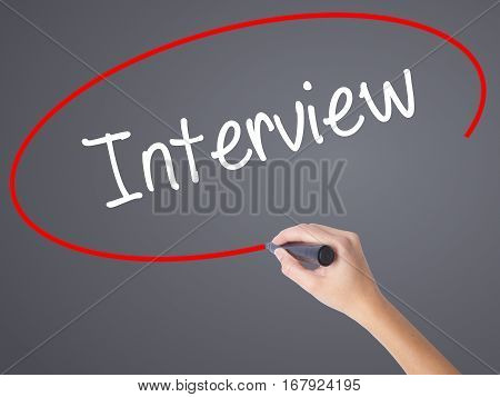 Woman Hand Writing Interview With Black Marker On Visual Screen