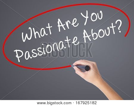 Woman Hand Writing What Are You Passionate About?  With Black Marker On Visual Screen