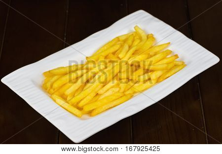 Close Up Crispy Potato Fries On White Dish