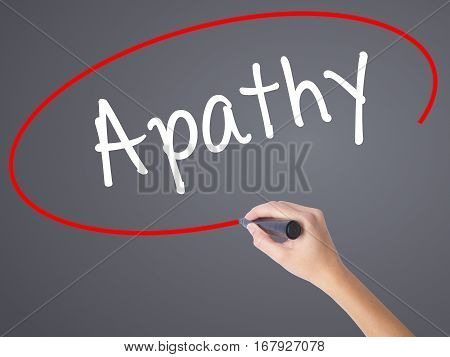 Woman Hand Writing Apathy  With Black Marker On Visual Screen