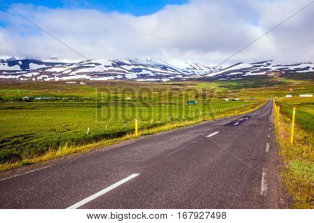The Iceland  highway in Tundra. Summer tour in the Nordic countries. The concept of extreme northern tourism