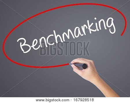 Woman Hand Writing Benchmarking  With Black Marker On Visual Screen