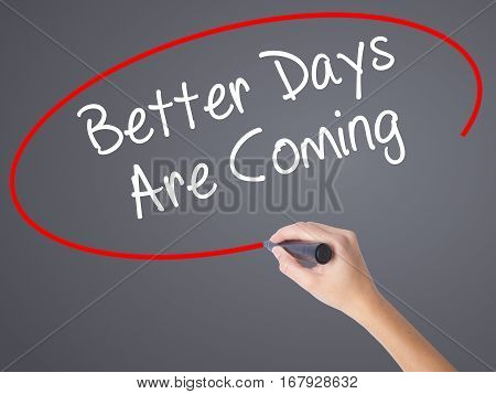 Woman Hand Writing Better Days Are Coming With Black Marker On Visual Screen.