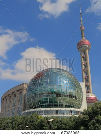 SHANGHAI CHINA - NOVEMBER 1, 2016: Shanghai International Conference Centre and Oriental Pearl TV tower.