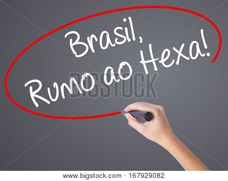 Woman Hand Writing Brasil, Rumo Ao Hexa! With Black Marker On Visual Screen.