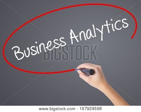 Woman Hand Writing Business Analytics With Black Marker On Visual Screen