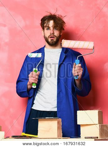 Builder Man Holding Paint Rollers
