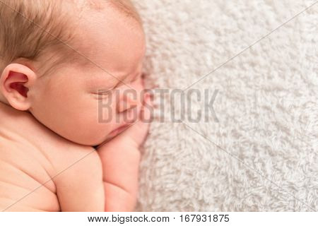 Sweet adorable child napping calmly after a long tough day, closeup