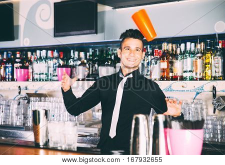 Flair bartender in action behind an american bar