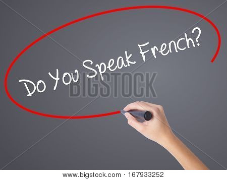 Woman Hand Writing Do You Speak French?  With Black Marker On Visual Screen