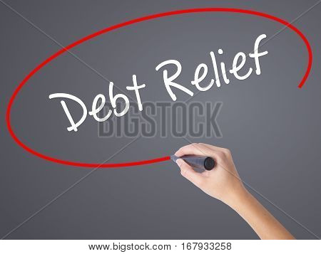 Woman Hand Writing Debt Relief With Black Marker On Visual Screen