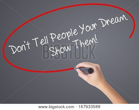 Woman Hand Writing Don't Tell People Your Dream