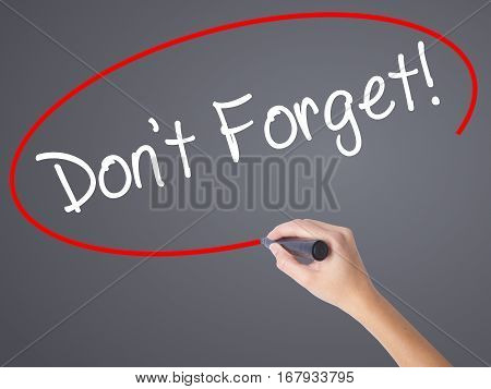 Woman Hand Writing Don't Forget!  With Black Marker On Visual Screen