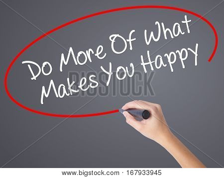Woman Hand Writing Do More Of What Makes You Happy With Black Marker On Visual Screen