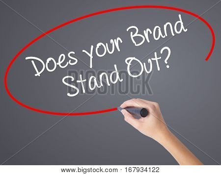 Woman Hand Writing Does Your Brand Stand Out? With Black Marker On Visual Screen