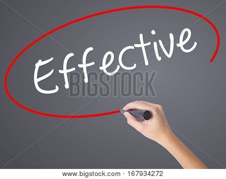 Woman Hand Writing Effective With Black Marker On Visual Screen.