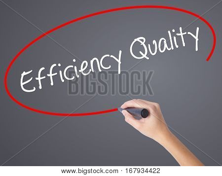 Woman Hand Writing Efficiency Quality  With Black Marker On Visual Screen.