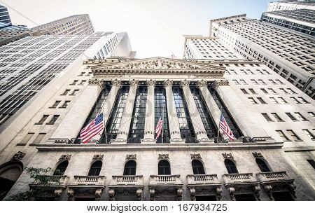 NEW YORK CITY NY SEPTEMBER 17 2015: The main building of New York Stock Exchange and a part of Wall Street in New York City. The Exchange building was built in 1903.