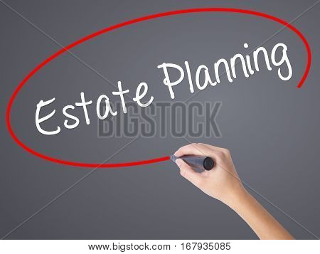 Woman Hand Writing Estate Planning With Black Marker On Visual Screen