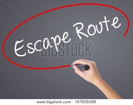 Woman Hand Writing Escape Route With Black Marker On Visual Screen