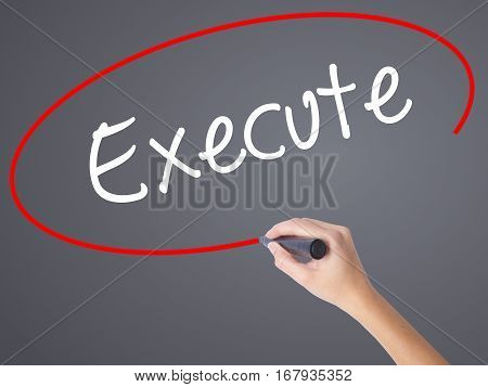 Woman Hand Writing Execute With Black Marker On Visual Screen