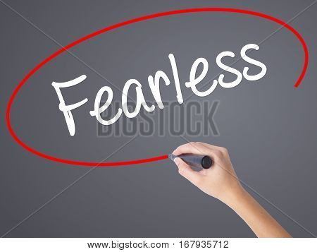 Woman Hand Writing Fearless With Black Marker On Visual Screen.