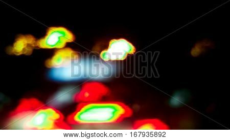 Night lights illuminate the streets , Abstract