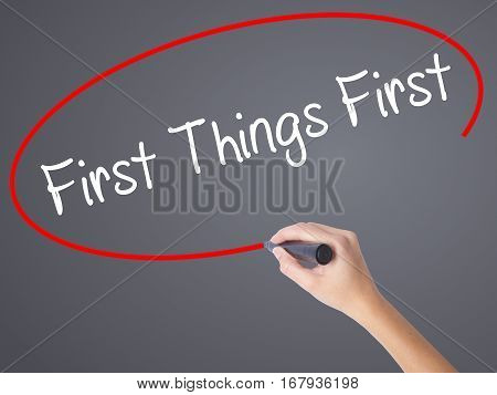 Woman Hand Writing First Things First With Black Marker On Visual Screen