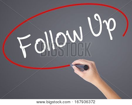 Woman Hand Writing Follow Up With Black Marker On Visual Screen