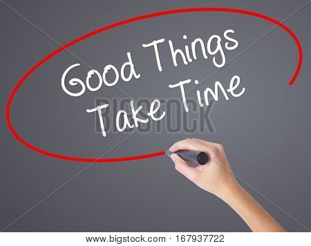 Woman Hand Writing Good Things Take Time With Black Marker On Visual Screen