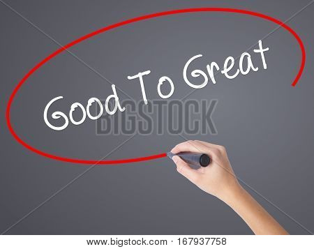 Woman Hand Writing Good To Great With Black Marker On Visual Screen