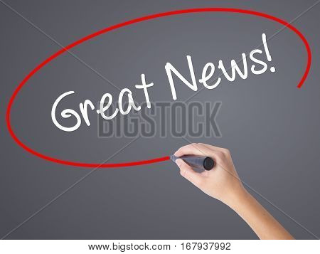 Woman Hand Writing Great News! With Black Marker On Visual Screen