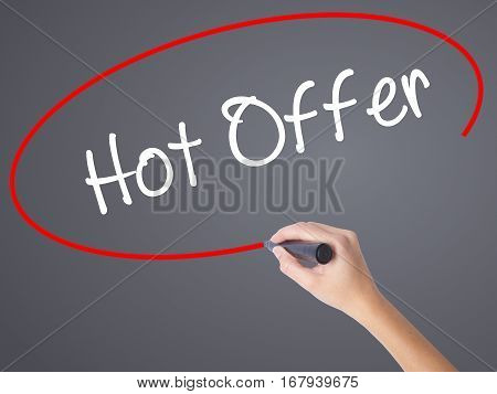 Woman Hand Writing Hot Offer With Black Marker On Visual Screen.