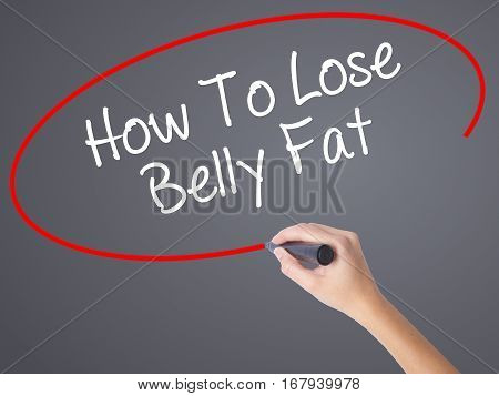 Woman Hand Writing How To Lose Belly Fat With Black Marker On Visual Screen