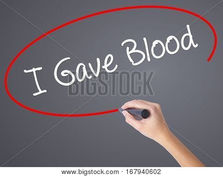 Woman Hand Writing I Gave Blood With Black Marker On Visual Screen