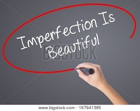 Woman Hand Writing Imperfection Is Beautiful With Black Marker On Visual Screen