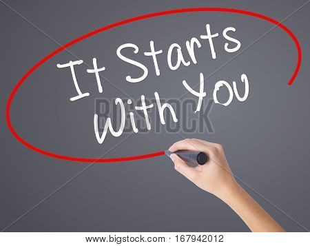 Woman Hand Writing It Starts With You With Black Marker On Visual Screen