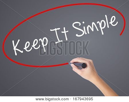 Woman Hand Writing Keep It Simple With Black Marker On Visual Screen