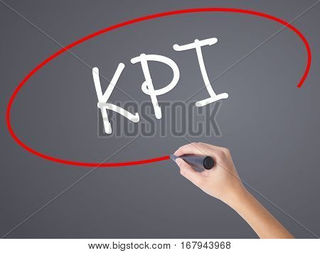 Woman Hand Writing Kpi (key Performance Indicator) With Black Marker On Visual Screen