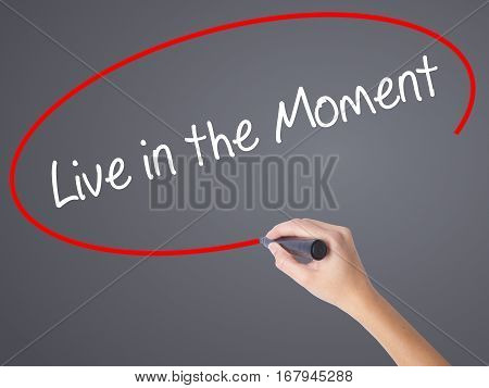 Woman Hand Writing Live In The Moment With Black Marker On Visual Screen