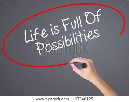 Woman Hand Writing Life Is Full Of Possibilities With Black Marker On Visual Screen