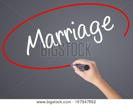 Woman Hand Writing Marriage With Black Marker On Visual Screen